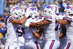 Buffalo Bills quarterback Jake Fromm (4) is congratulated after his touchdown during the second half of a preseason NFL football game against the Green Bay Packers, Saturday, Aug. 28, 2021, in Orchard Park, N.Y. (AP Photo/Jeffrey T. Barnes)