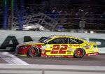 Joey Logano (22) approaches the finish line to win a NASCAR Cup Series Championship auto race at the Homestead-Miami Speedway, Sunday, Nov. 18, 2018, in Homestead, Fla. (AP Photo/Terry Renna)