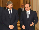 FILE - In this Sept. 17, 2018 file photo, released by the Egyptian Presidency, Egyptian President Abdel-Fattah el-Sissi, right, walks with Roberto Fico, president of Italy's Chamber of Deputies, in Cairo, Egypt. Fico complained that Cairo has not made much progress on the unresolved case of an Italian student gruesomely killed in Cairo in 2016. Suspicion in Italy fell on Egypt's security forces, notorious for their abuses. The disappearance of Saudi Journalist Jamal Khashoggi, during a visit to his country's consulate in Istanbul on Oct. 2, 2018, raises a dark question for anyone who dares criticize governments or speak out against those in power: Will the world have their back? (Egyptian Presidency via AP, File)