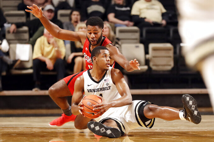 Southeast Missouri State guard Chris Harris, top, battles Vanderbilt guard Jordan Wright for the ball in the first half of an NCAA college basketball game Wednesday, Nov. 6, 2019, in Nashville, Tenn. (AP Photo/Mark Humphrey)