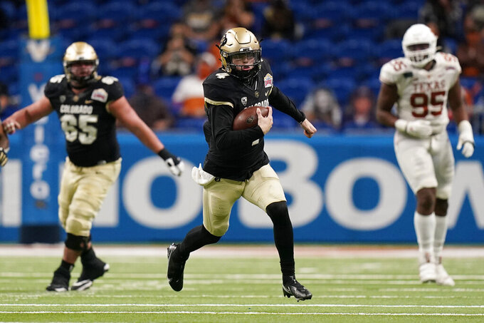 Colorado quarterback Sam Noyer (4) runs for a first down against Texas during the first half of the Alamo Bowl NCAA college football game Tuesday, Dec. 29, 2020, in San Antonio. (AP Photo/Eric Gay)