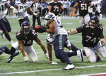 Seattle Seahawks linebacker Bobby Wagner (54) runs after recovering a fumble by Atlanta Falcons running back Devonta Freeman (24) at the Seahawks one-yard line during the fourth quarter of an NFL football game on Sunday, Oct. 27, 2019, in Atlanta. (Curtis Compton/Atlanta Journal-Constitution via AP)
