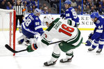 Minnesota Wild left wing Jason Zucker (16) watches his goal get past Tampa Bay Lightning goaltender Andrei Vasilevskiy (88) during the first period of an NHL hockey game Thursday, Dec. 5, 2019, in Tampa, Fla. (AP Photo/Chris O'Meara)