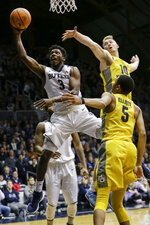 Butler guard Kamar Baldwin (3) shoots between Marquette defenders Sam Hauser (1) and Greg Elliott (5) during the first half of an NCAA college basketball game in Indianapolis, Friday, Jan. 12, 2018. (AP Photo/AJ Mast)