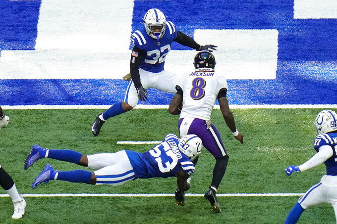 Indianapolis Colts outside linebacker Darius Leonard (53) tackles Baltimore Ravens quarterback Lamar Jackson (8) in the second half of an NFL football game in Indianapolis, Sunday, Nov. 8, 2020. (AP Photo/AJ Mast)