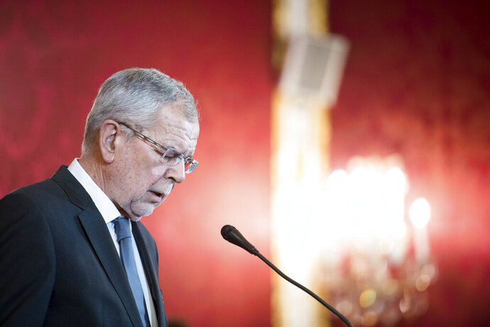 Austrian President Alexander van der Bellen addresses the media during a press conference at the Hofburg palace in Vienna, Austria, Saturday, May 18, 2019. Austrian Chancellor Sebastian Kurz has called for an early election after the resignation of his vice chancellor spelled an end to his governing coalition. (AP Photo/Michael Gruber)