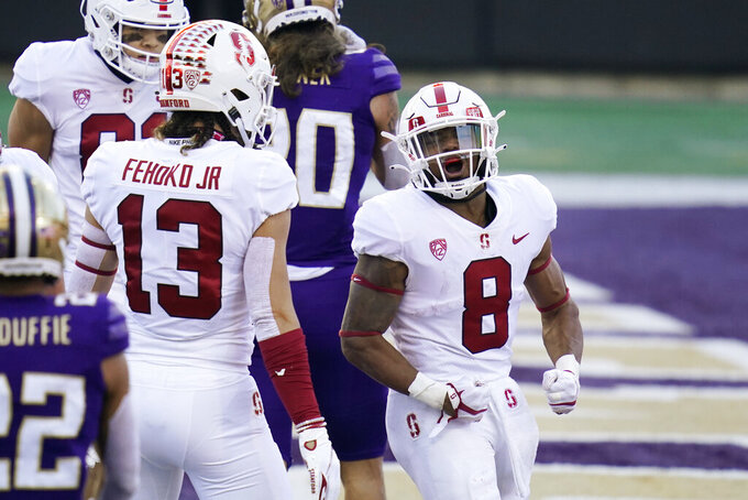 Stanford running back Nathaniel Peat (8) reacts after scoring against Washington in the first half of an NCAA college football game Saturday, Dec. 5, 2020, in Seattle. (AP Photo/Elaine Thompson)