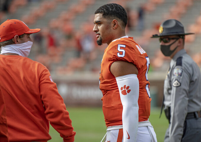 Clemson head coach Dabo Swinney and quarterback D.J. Uiagalelei(5) walk off the field after an NCAA college football game against Boston College   Saturday, Oct. 31, 2020, in Clemson, S.C. (Josh Morgan/Pool Photo via AP)