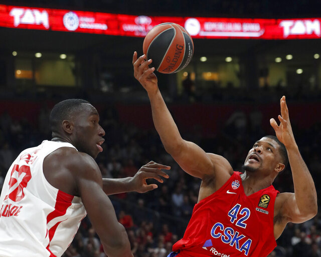 In this photo taken Friday, Feb. 21, 2020, CSKA Moscow's Kyle Hines, right, tries to score as Red Star's Michael Ojo block him during their Euroleague basketball match in Belgrade, Serbia. Former Florida State center Michael Ojo has died after collapsing during training in Serbia. Serbian Media and his former teammates say the 27-year-old Nigerian-born basketball player was on Friday taken to a hospital in the Serbian capital, but doctors failed to revive him. (AP Photo/Darko Vojinovic)