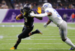 Appalachian State running back Darrynton Evans (3) carries against Middle Tennessee safety Kendricks Gladney (38) in the first half of the New Orleans Bowl NCAA college football game in New Orleans, Saturday, Dec. 15, 2018. (AP Photo/Gerald Herbert)