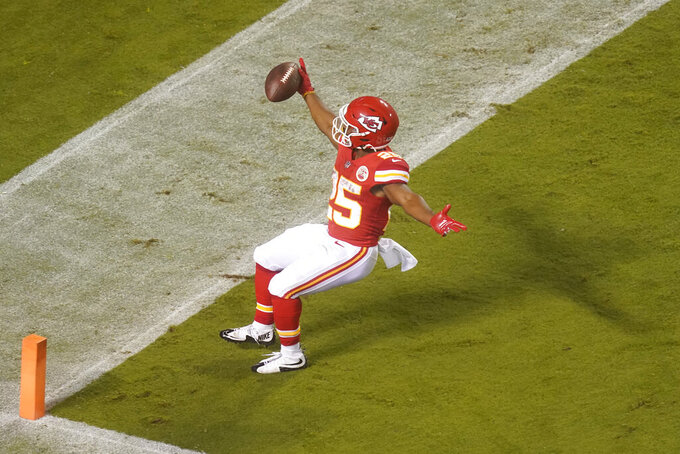 Kansas City Chiefs running back Clyde Edwards-Helaire scores a touchdown on a 27-yard run against the Houston Texans in the second half of an NFL football game Thursday, Sept. 10, 2020, in Kansas City, Mo. (AP Photo/Charlie Riedel)
