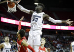 Utah State's Neemias Queta (23) blocks a shot from New Mexico's Anthony Mathis during the second half of an NCAA college basketball game in the Mountain West Conference men's tournament Thursday, March 14, 2019, in Las Vegas. (AP Photo/Isaac Brekken)