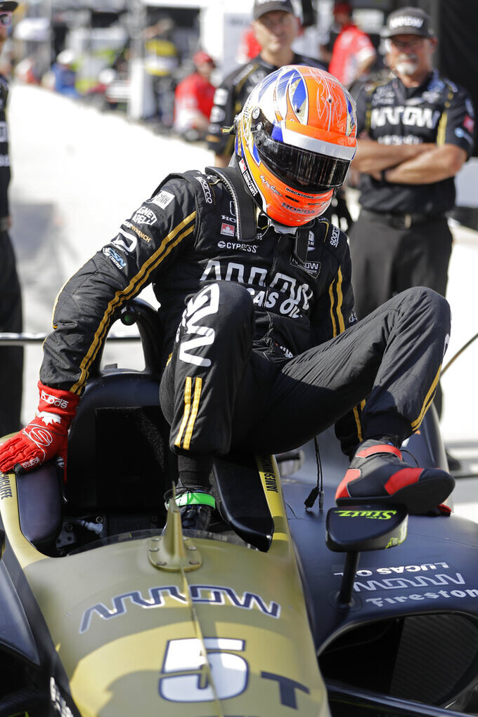 James Hinchcliffe, of Canada, climbs out of his car during qualifications for the Indianapolis 500 IndyCar auto race at Indianapolis Motor Speedway, Saturday, May 18, 2019, in Indianapolis. (AP Photo/Darron Cummings)