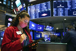 In this photo provided by the New York Stock Exchange, trader Ashley Lara uses her handheld device as she works on the trading floor, Tuesday, Dec. 1, 2020. U.S. stocks rose broadly in morning trading Tuesday, sending the S&P 500 toward another record high, as investors focus on the possibility that coronavirus vaccines could soon help usher in a fuller global economic recovery. (Colin Ziemer/New York Stock Exchange via AP)