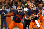 Maryland linebacker Durell Nchami, center, gets by Illinois offensive lineman Vederian Lowe (79) and sacks quarterback Brandon Peters during the first half of an NCAA college football game Friday, Sept. 17, 2021, in Champaign, Ill. (AP Photo/Charles Rex Arbogast)