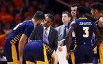 Chattanooga head coach Lamont Paris talks to forward Ramon Vila (15) during the second half of an NCAA college basketball game against Tennessee Monday, Nov. 25, 2019, in Knoxville, Tenn. (AP Photo/Wade Payne)