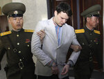 FILE - In this March 16, 2016, file photo, American student Otto Warmbier, center, is escorted at the Supreme Court in Pyongyang, North Korea. President Donald Trump says he doesn't think North Korean leader Kim Jong Un was involved in the mistreatment of American college student Otto Warmbier, who died after being detained in the North. Trump says of Kim: