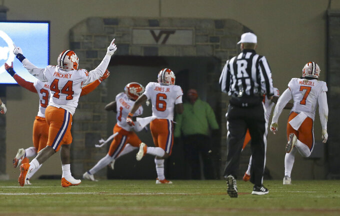 Clemson players celebrate a fumble return for a touchdown during the third quarter against Virginia Tech in an NCAA college football game Saturday, Dec. 5, 2020, in Blacksburg, Va. (Matt Gentry/The Roanoke Times via AP, Pool)