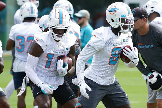 Miami Dolphins Wide receivers Allen Hurns (8) and DeVanter Parker (11) run drills during an NFL football practice, Monday, Aug. 2, 2021, in Miami Gardens, Fla. (AP Photo/Marta Lavandier)
