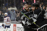 Los Angeles Kings center Michael Amadio, right, celebrates his goal with left wing Nikolai Prokhorkin, center, of Russia, with Edmonton Oilers defenseman Caleb Jones, left, skating away during the second period of an NHL hockey game in Los Angeles, Thursday, Nov. 21, 2019. (AP Photo/Alex Gallardo)