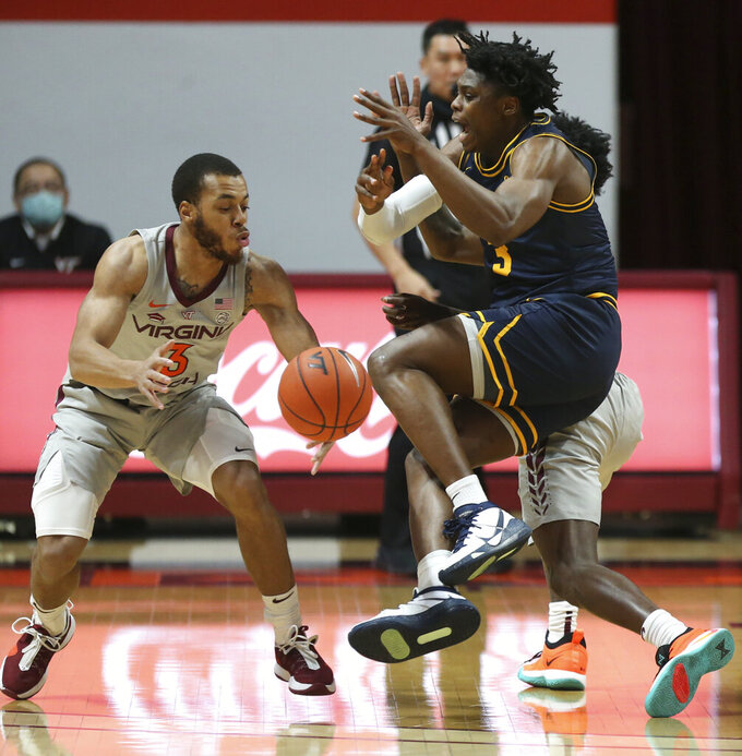 Coppin State's Anthony Tarke, right, loses the ball while guarded by Virginia Tech's Wabissa Bede (3) during the first half of an NCAA college basketball game, Saturday, Dec. 19, 2020 in Blacksburg, Va. (Matt Gentry/The Roanoke Times via AP, Pool)