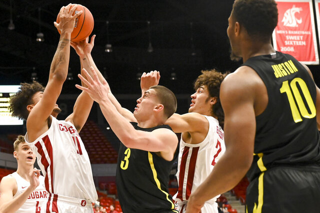 Washington State forward DJ Rodman (11) pulls down a rebound away from Oregon guard Payton Pritchard (3) as forward CJ Elleby (2) watches during the first half of an NCAA college basketball game, Thursday, Jan. 16, 2020, in Pullman, Wash. (AP Photo/Pete Caster)