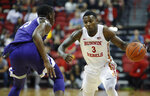 UNLV's Amauri Hardy (3) drives around Kansas State's Montavious Murphy during the first half of an NCAA college basketball game Saturday, Nov. 9, 2019, in Las Vegas. (AP Photo/John Locher)