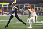 New England Patriots quarterback Tom Brady, left, rolls out to pass under pressure from Cleveland Browns defensive tackle Sheldon Richardson in the second half of an NFL football game, Sunday, Oct. 27, 2019, in Foxborough, Mass. (AP Photo/Elise Amendola)