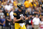 Iowa quarterback Spencer Petras (7) throws a pass during the first half of an NCAA college football game against Indiana, Saturday, Sept. 4, 2021, in Iowa City, Iowa. (AP Photo/Charlie Neibergall)