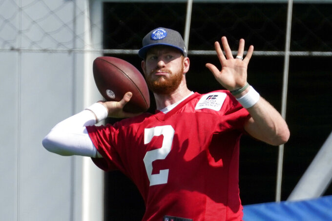 Indianapolis Colts quarterback Carson Wentz (2) throws during NFL football practice, Thursday, May 20, 2021, in Indianapolis. (AP Photo/Darron Cummings)