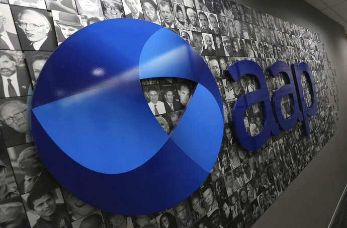 In this March 3, 2020, photo, the logo of the Australian Associated Press is seen in it's Rhodes headquarters in Sydney. Australia's national news agency will continue with new owners, the board confirmed Friday, just weeks before it was due to be shut down. (Danny Casey/AAP Image via AP)