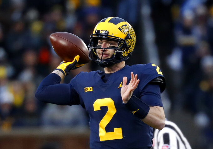 FILE - In this Nov. 17, 2018, file photo, Michigan quarterback Shea Patterson (2) throws against Indiana in the first half of an NCAA college football game against Indiana in Ann Arbor, Mich. Patterson is returning for his senior season at Michigan instead of entering the NFL draft. The quarterback announced his decision on Twitter. (AP Photo/Paul Sancya, File)