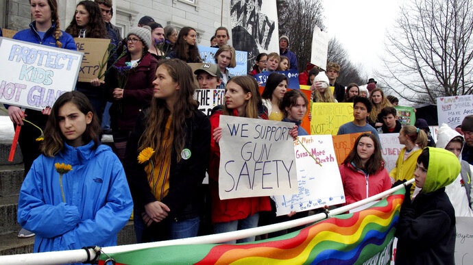 Gun control advocates demonstrate at the Vermont Statehouse in Montpelier, Vt., on Tuesday Feb. 20, 2018. The demonstration followed comments by Republican Gov. Phil Scott who said he was open to discussion about gun control as part of a broader discussion of ways to reduce violence. Scott's comments came after Vermont police arrested a suspect who they say was preparing for a school shooting. Vermont has long been considered to have some of the most lax gun control laws in the country. (AP Photo/Wilson Ring)