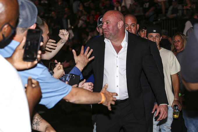 Dana White, president of the Ultimate Fighting Championship, greets fans during a UFC 261 mixed martial arts event, Saturday, April 24, 2021, in Jacksonville, Fla. It is the first UFC event since the onset of the COVID-19 pandemic to feature a full crowd in attendance. (AP Photo/Gary McCullough)