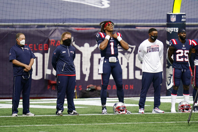 "New England Patriots including head coach Bill Belichick, left, quarterback Cam (1) and defensive back Terrence Brooks (25) stand during the singing of ""Lift Every Voice and Sing"" before an NFL football game against the Miami Dolphins, Sunday, Sept. 13, 2020, in Foxborough, Mass. (AP Photo/Charles Krupa)"