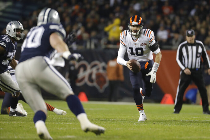 Chicago Bears quarterback Mitchell Trubisky (10) runs against Dallas Cowboys' Sean Lee (50) during the first half of an NFL football game, Thursday, Dec. 5, 2019, in Chicago. (AP Photo/Morry Gash)