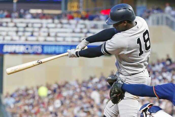 New York Yankees' Didi Gregorius hits a two-run triple off Minnesota Twins pitcher Jake Odorizzi in the fourth inning of a baseball game Wednesday, July 24, 2019, in Minneapolis. (AP Photo/Jim Mone)