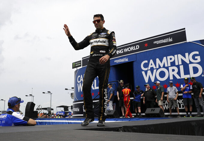 Aric Almirola waves to the crowd during drivers introduction before the NASCAR Cup Series auto race at Chicagoland Speedway in Joliet, Ill., Sunday, June 30, 2019. (AP Photo/Nam Y. Huh)
