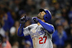 Los Angeles Dodgers' Matt Kemp reacts after hitting a three-run home run during the third inning of a baseball game against the San Diego Padres Monday, April 16, 2018, in San Diego. (AP Photo/Gregory Bull)