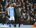 Manchester City manager Josep Guardiola gives instruction to Manchester City's Gabriel Jesus during the English Premier League soccer match between Manchester City and Chelsea at Etihad stadium in Manchester, England, Sunday, Feb. 10, 2019. (AP Photo/Rui Vieira)