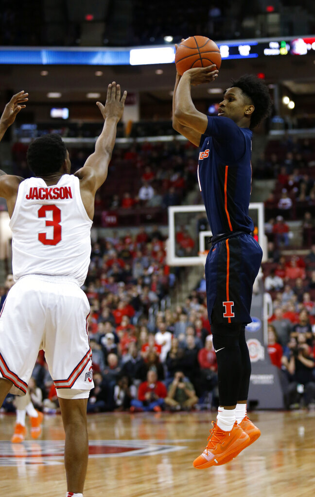 Illinois guard Trent Frazier, right, goes up for a shot against Ohio State guard C.J. Jackson during the first half of an NCAA college basketball game in Columbus, Ohio, Thursday, Feb. 14, 2019. (AP Photo/Paul Vernon)