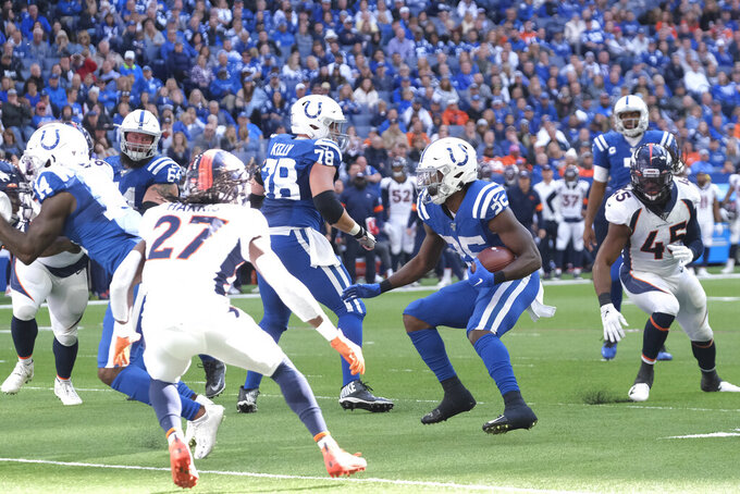Indianapolis Colts' Marlon Mack (25) runs for a touchdown during the second half of an NFL football game against the Denver Broncos, Sunday, Oct. 27, 2019, in Indianapolis. (AP Photo/AJ Mast)