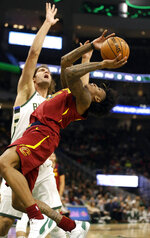 Cleveland Cavaliers' Kevin Porter Jr., right, shoots against Milwaukee Bucks' Robin Lopez during the second half of an NBA basketball game Monday, Oct. 28, 2019, in Milwaukee. (AP Photo/Jeffrey Phelps)