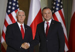 U.S. Vice President Mike Pence, left, shakes hands with Polish President Andrzej Duda in Warsaw, Poland, Monday, Sept. 2, 2019. The U.S. and Poland signed an agreement on Monday to cooperate on new 5G technology amid growing concerns about Chinese telecommunications giant Huawei. (AP Photo/Petr David Josek)