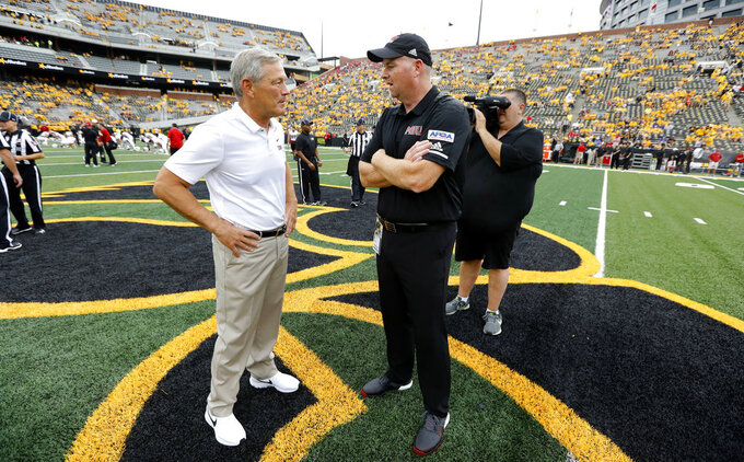 Iowa head coach Kirk Ferentz, left, talks with Northern Illinois head coach Rod Carey, right, before an NCAA college football game, Saturday, Sept. 1, 2018, in Iowa City, Iowa. (AP Photo/Charlie Neibergall)