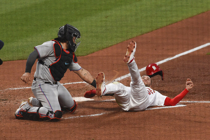 Miami Marlins catcher Jorge Alfaro tags out St. Louis Cardinals center fielder Dylan Carlson during the third inning of a baseball game Monday, June 14, 2021, in St. Louis. (AP Photo/Joe Puetz)