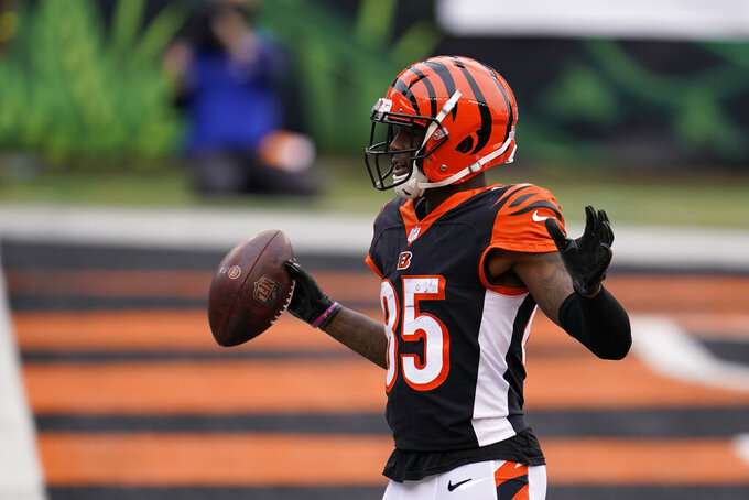 Cincinnati Bengals' Tee Higgins (85) celebrates a touchdown during the second half of an NFL football game against the Cleveland Browns, Sunday, Oct. 25, 2020, in Cincinnati. (AP Photo/Michael Conroy)