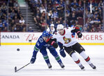 Vancouver Canucks' Ashton Sautner, left, and Ottawa Senators' Max Veronneau vie for the puck during the first period of an NHL hockey game Wednesday, March 20, 2019, in Vancouver, British Columbia. (Darryl Dyck/The Canadian Press via AP)