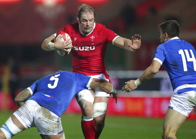 Wales' Alun Wyn Jones, right, is tackled by Italy's Niccolo Cannone, during the Autumn Nations Cup rugby match between Wales and Italy at Parc y Scarlets, in Llanelli, Wales, Saturday Dec. 5, 2020. (David Davies/PA via AP)