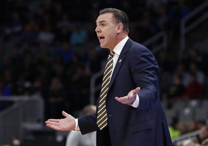 UC Irvine head coach Russell Turner gestures during the first half against Kansas State during a first-round game in the NCAA men's college basketball tournament  Friday, March 22, 2019, in San Jose, Calif. (AP Photo/Chris Carlson)